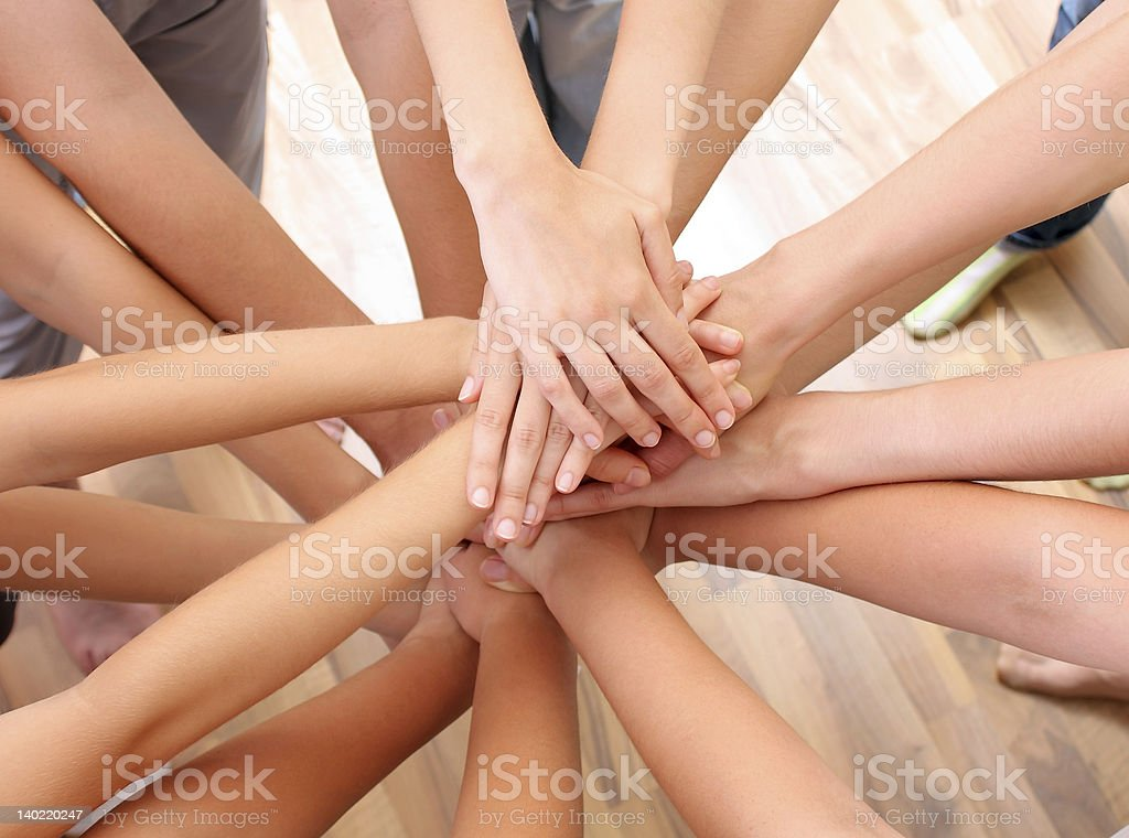 Young hands on top of each other stock photo