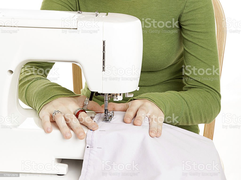 Young Hands Sewing royalty-free stock photo