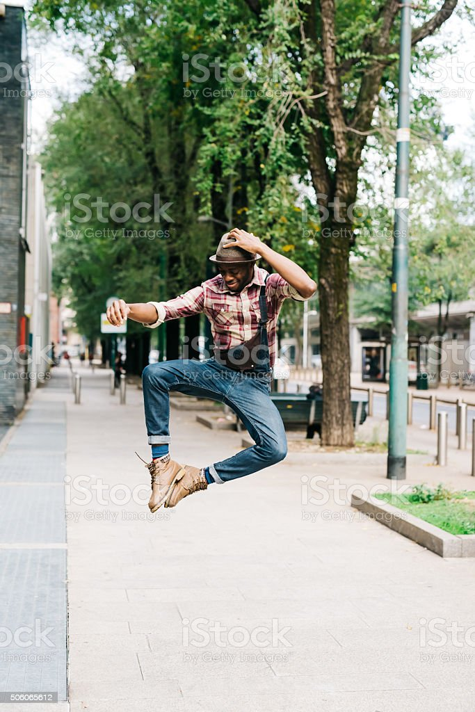 Young handsome afro back man jumping stock photo