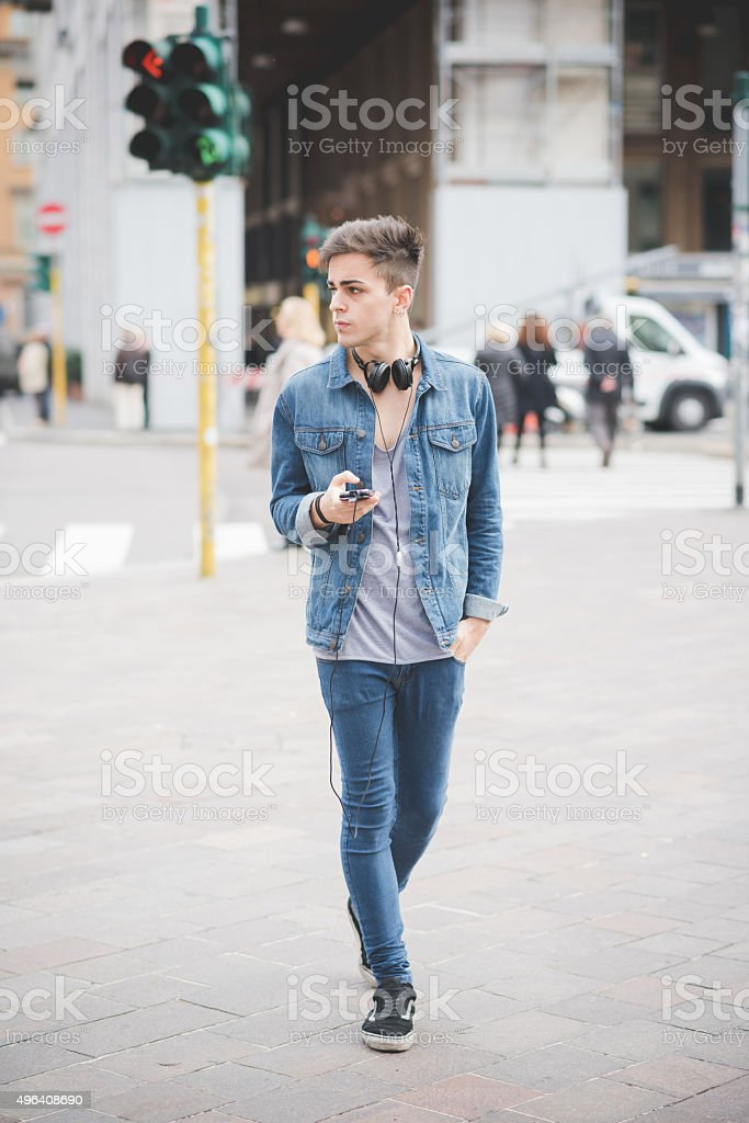 young handsome alternative dark model man in town stock photo