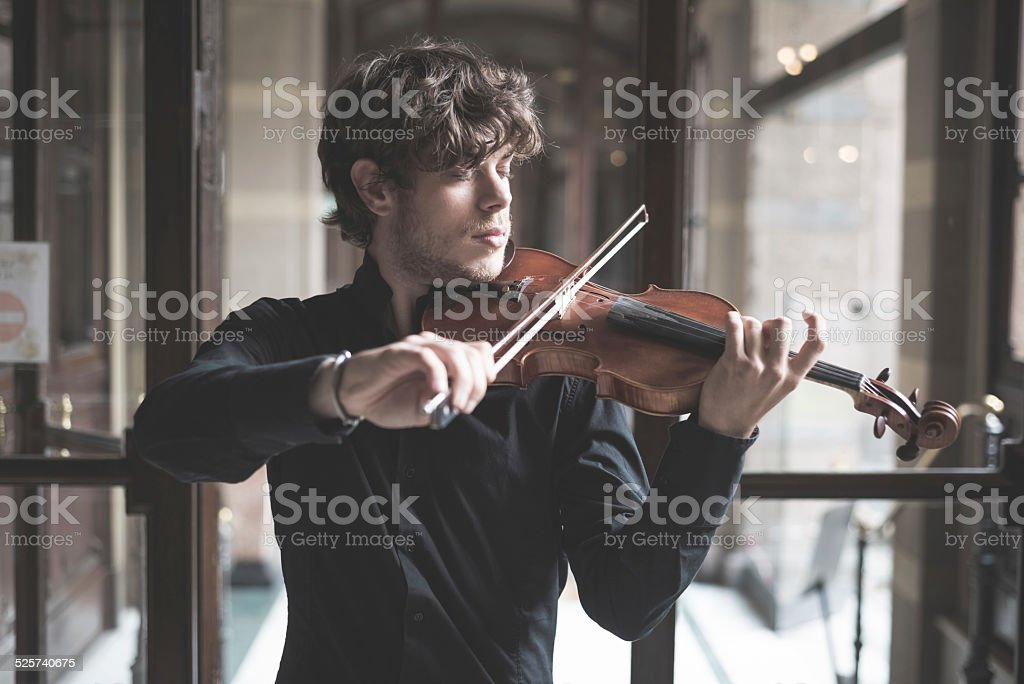 young handsome blonde violinist stock photo