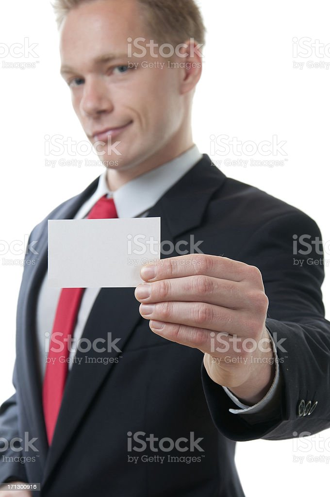Young handsome businessman holding white card stock photo