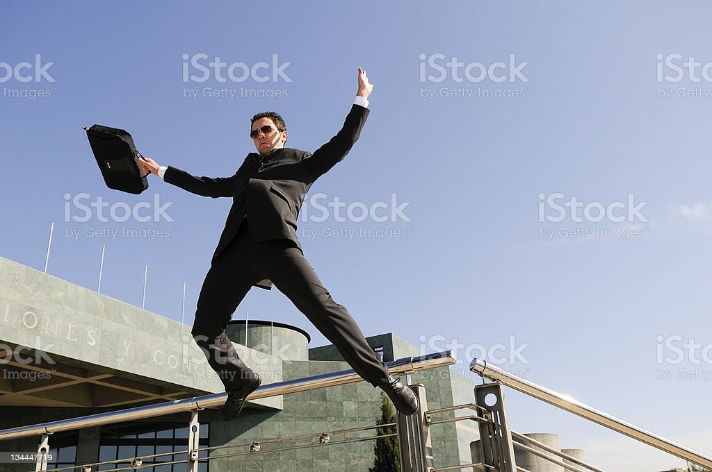 Young handsome businessman jumping in the street royalty-free stock photo