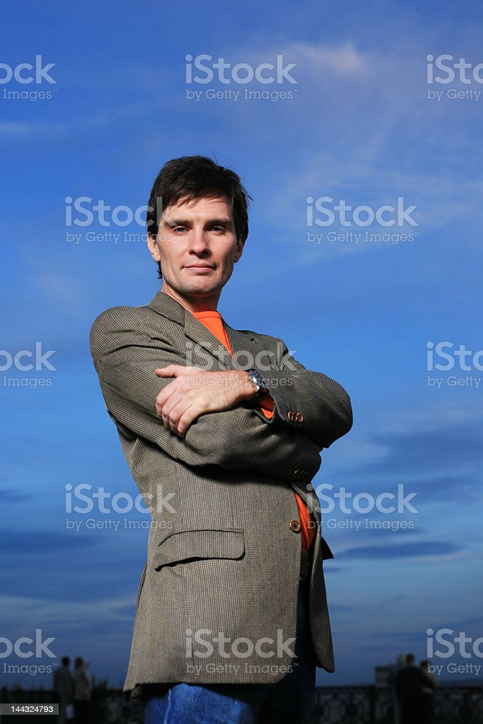young handsome businessman over blue sky royalty-free stock photo