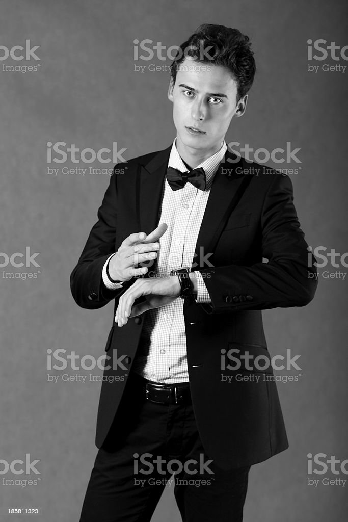 Young handsome businessman pointing at watch royalty-free stock photo