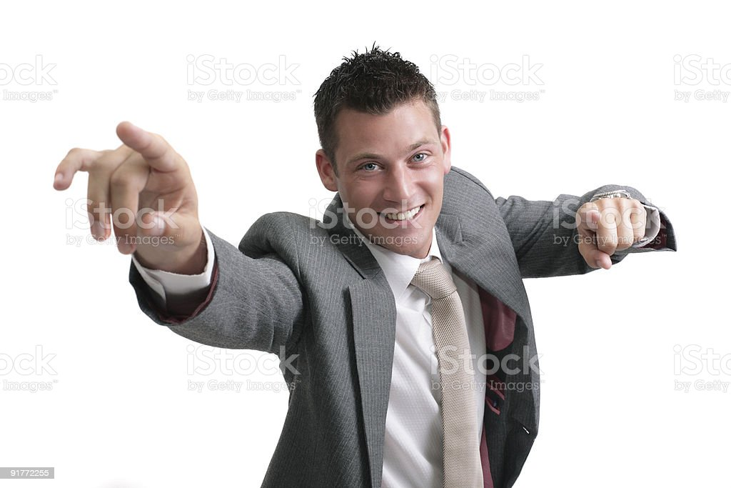 young handsome businessman pointing forward royalty-free stock photo