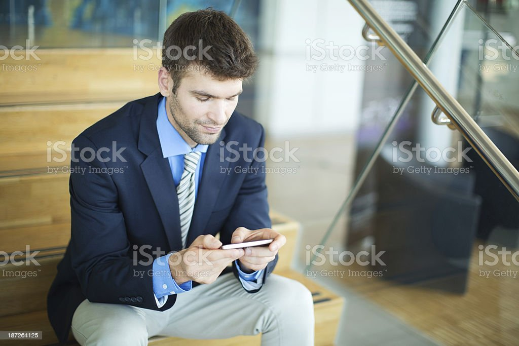 Young handsome businessman sitting on stairs. royalty-free stock photo