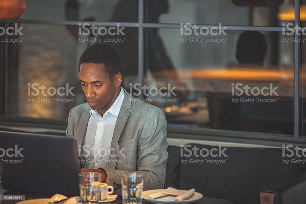 Young handsome businessman working on a laptop stock photo