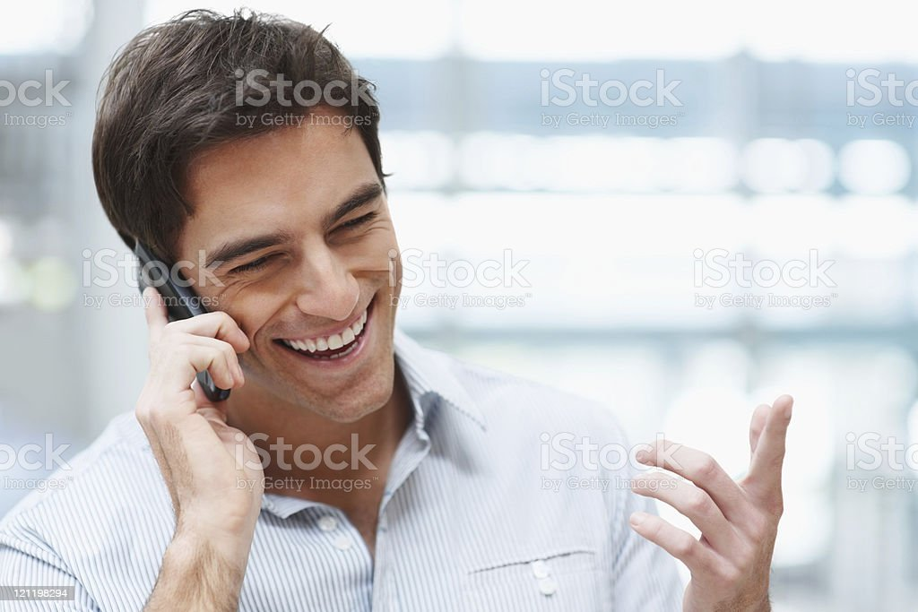 Young handsome guy enjoying a telephonic conversation royalty-free stock photo