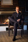 Young handsome guy in front of a fireplace