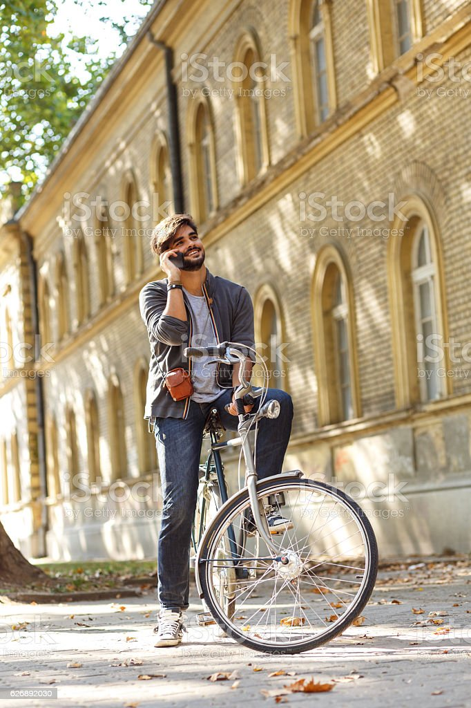 Young handsome guy on a bicycle. stock photo