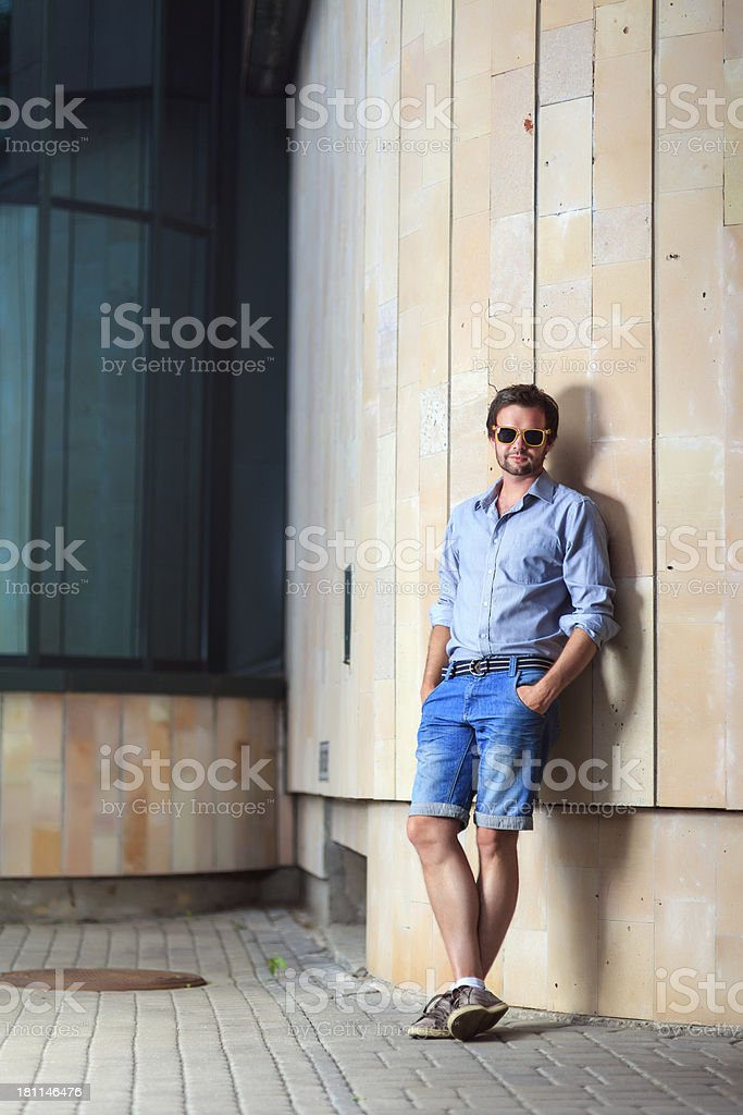 Young handsome man aginst wall royalty-free stock photo