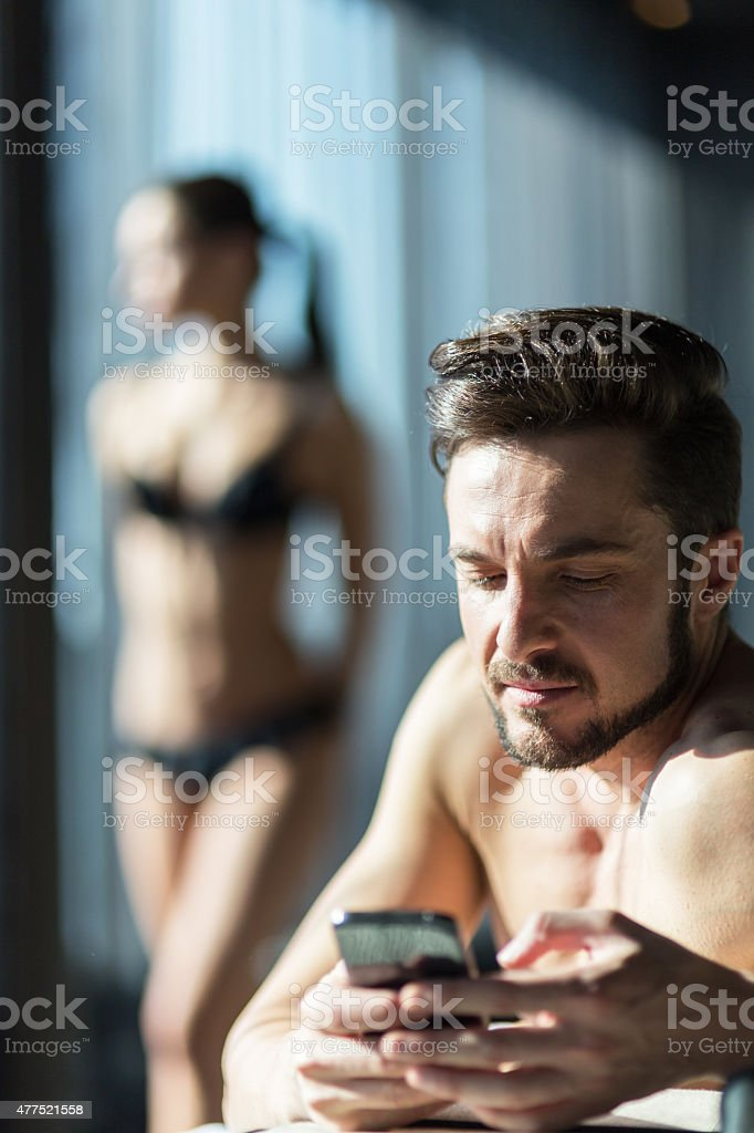 Young, handsome man cheating on his wife stock photo