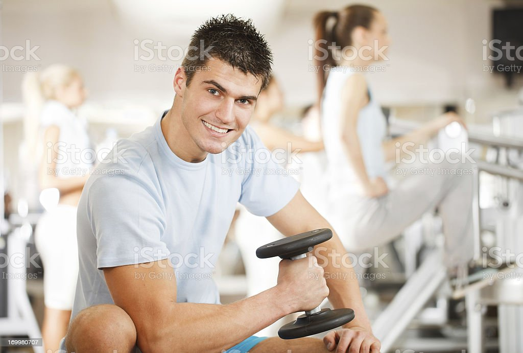Young handsome man doing exercise at the gym. royalty-free stock photo