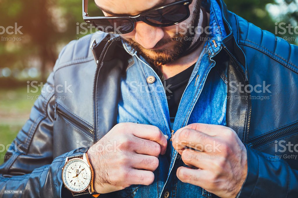 Young handsome man dressing up and buckle shirt stock photo