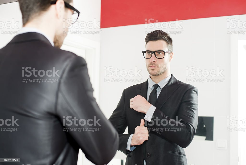 Young handsome man fix his suit royalty-free stock photo