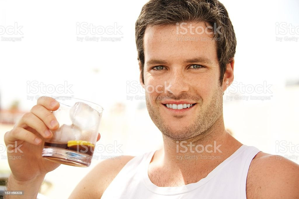 Young handsome man having a drink outdoors royalty-free stock photo