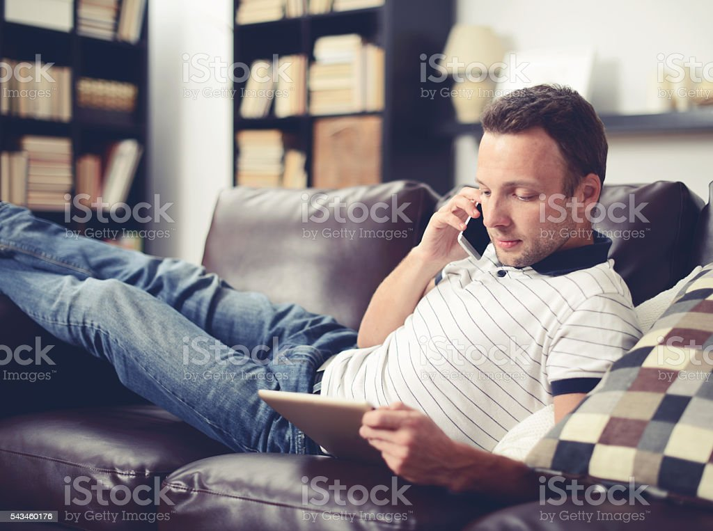Young, handsome man in home interior stock photo