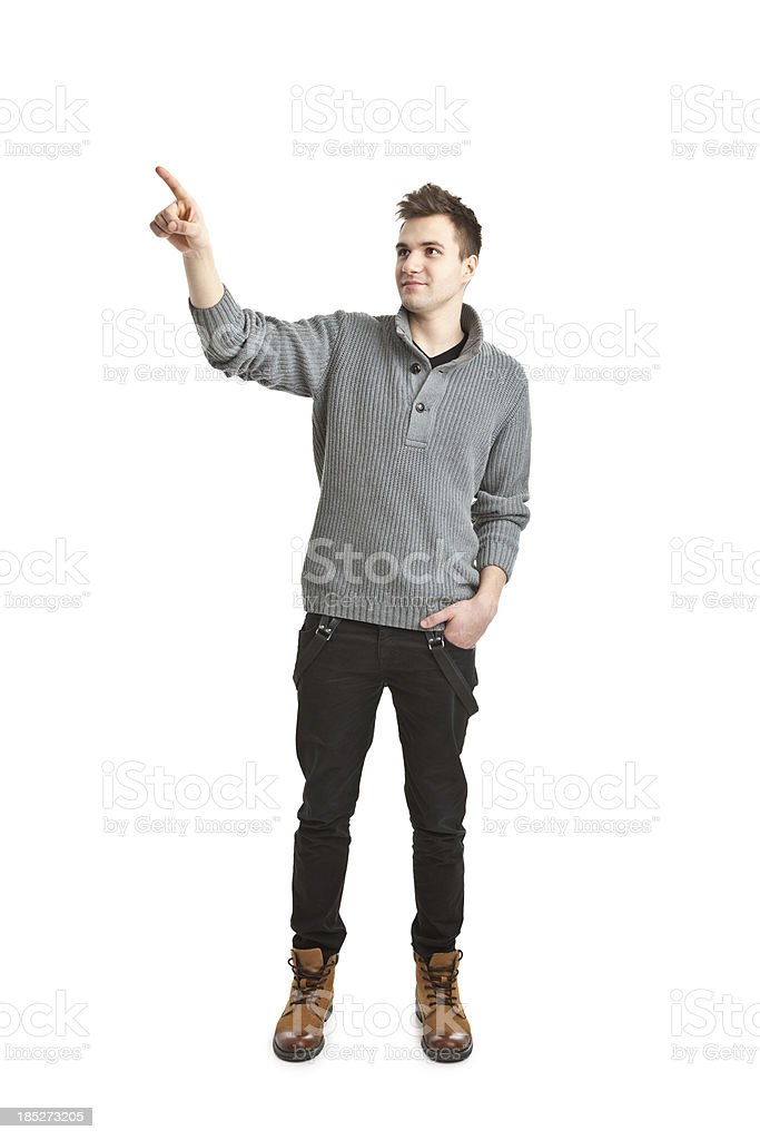 young handsome man in sweater pointing royalty-free stock photo
