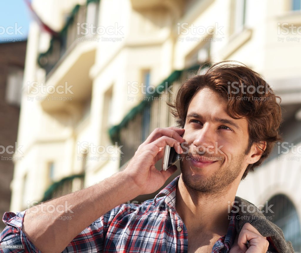 young handsome man on cell phone royalty-free stock photo