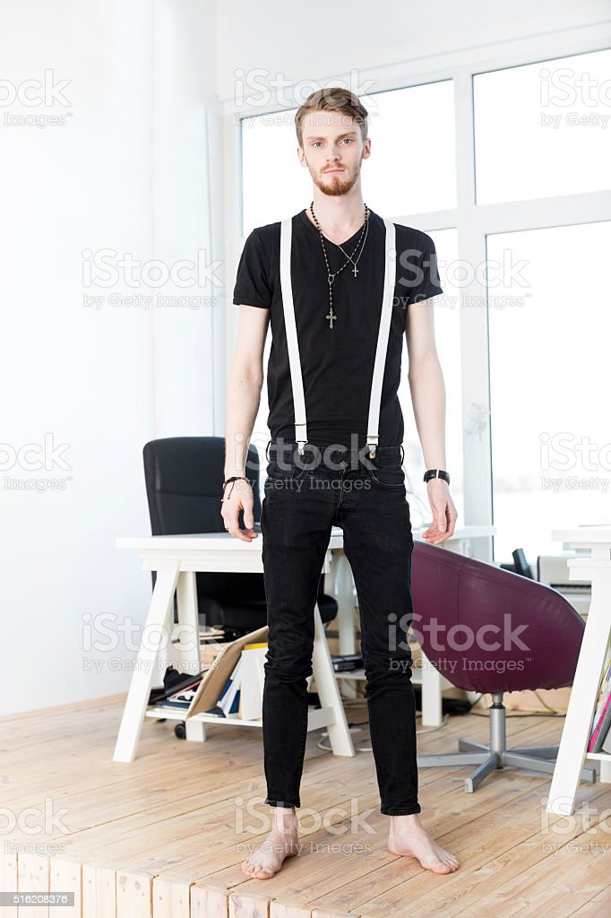 Young Handsome Man Standing In A Modern Office stock photo