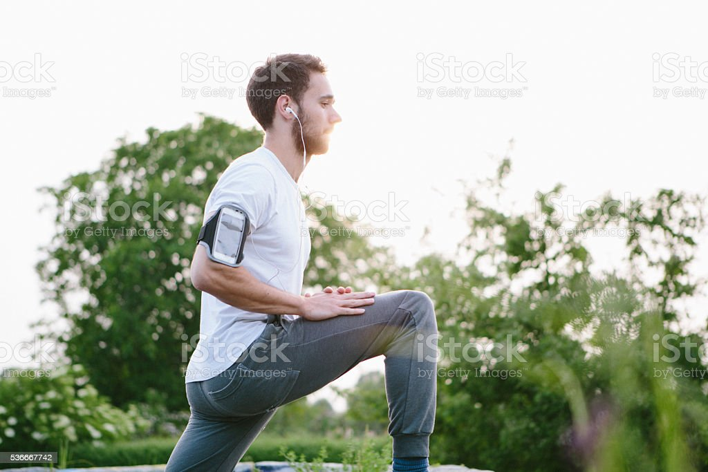 young handsome man use wearable for sport in park stock photo