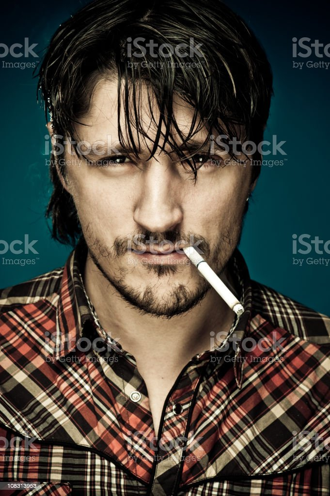 Young handsome man with a cigarette royalty-free stock photo