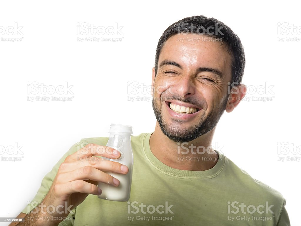 Young Handsome Man with Beard drinking Milk royalty-free stock photo
