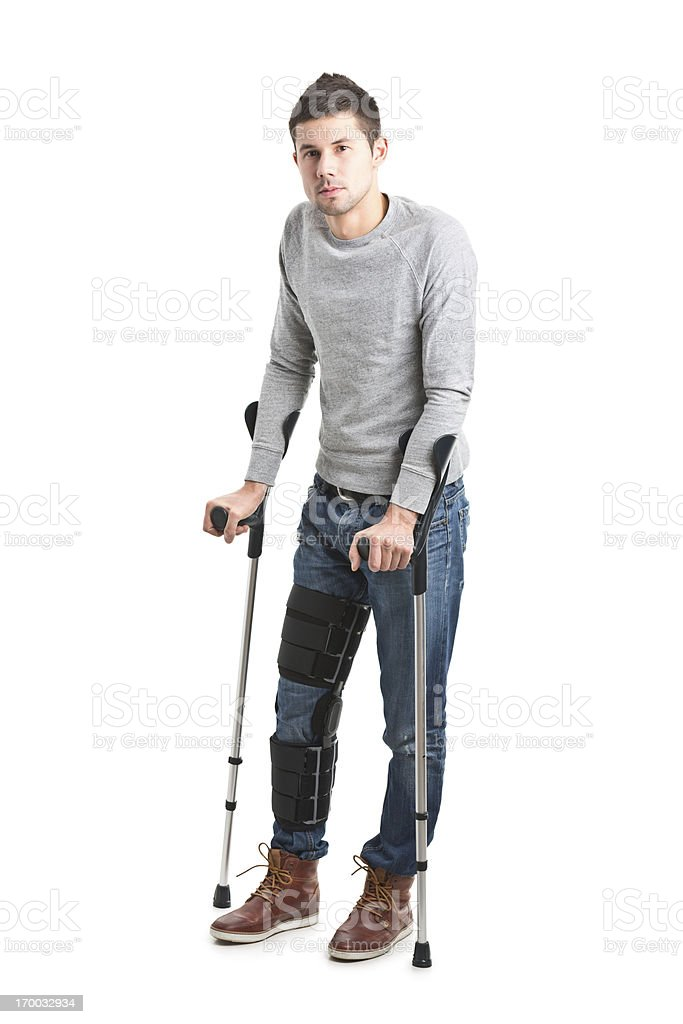 young handsome man with broken leg stock photo