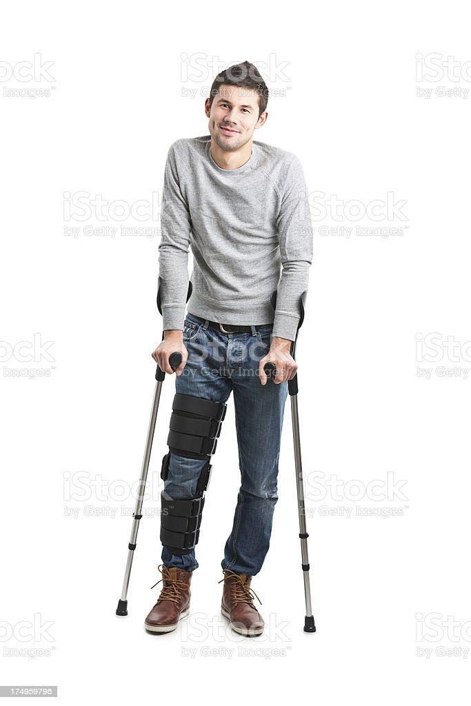 young handsome man with broken leg royalty-free stock photo