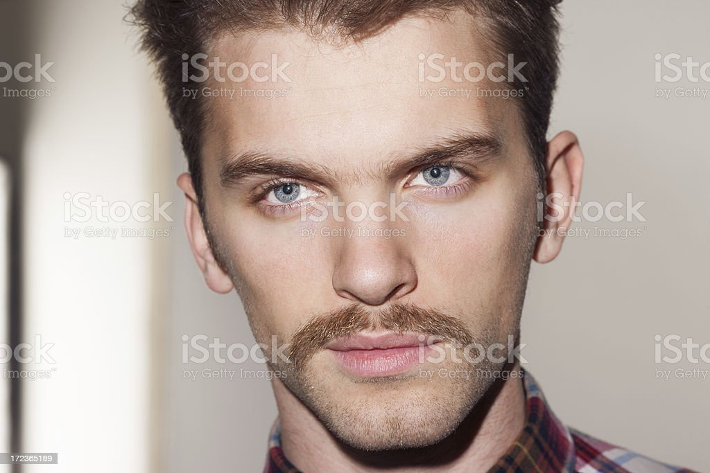 young handsome man with mustache royalty-free stock photo
