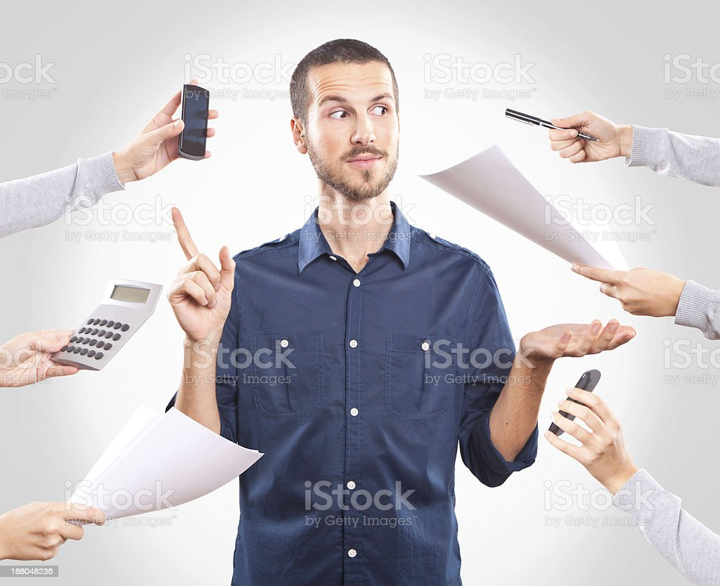 Young handsome man working stock photo