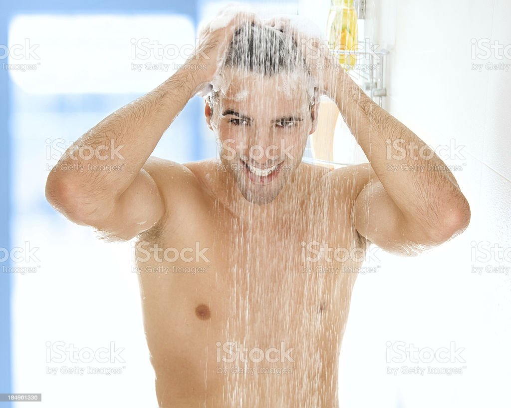 Young handsome men taking a shower. royalty-free stock photo