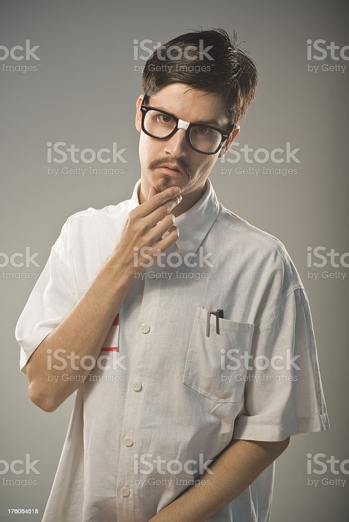 Young handsome nerd thinking royalty-free stock photo