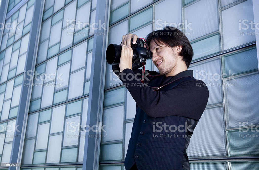 young handsome photographer taking photos royalty-free stock photo