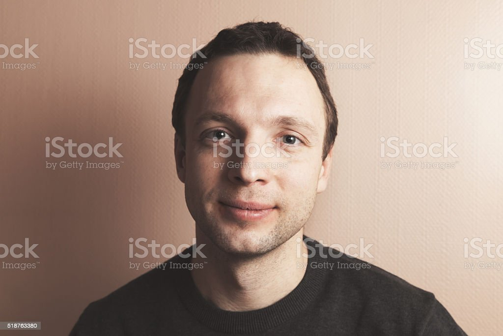 Young handsome positive Caucasian man portrait stock photo