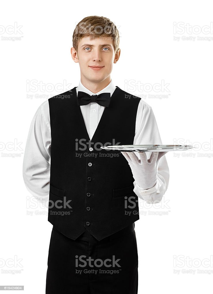 Young handsome waiter holding empty tray stock photo