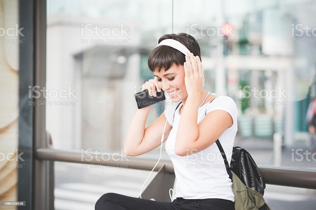 Young handsome woman listening music stock photo