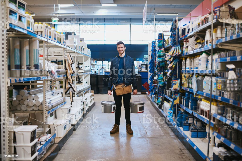 Young handyman posing in a hardware store stock photo