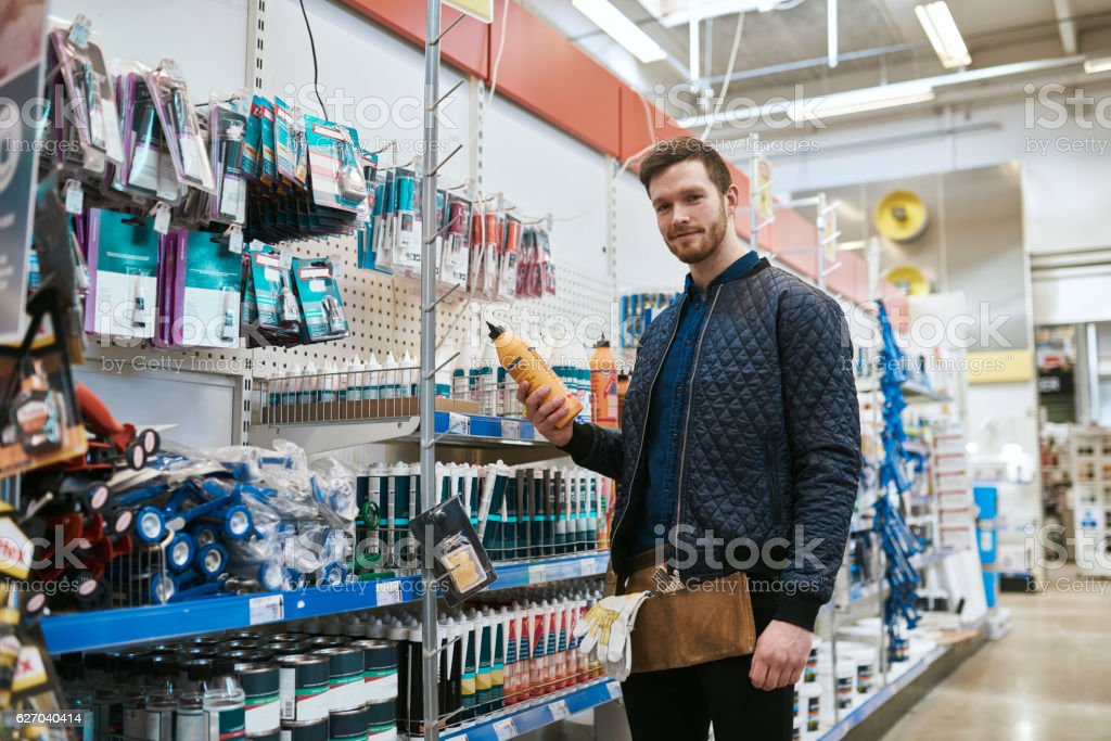 Young handyman shopping in a hardware store stock photo
