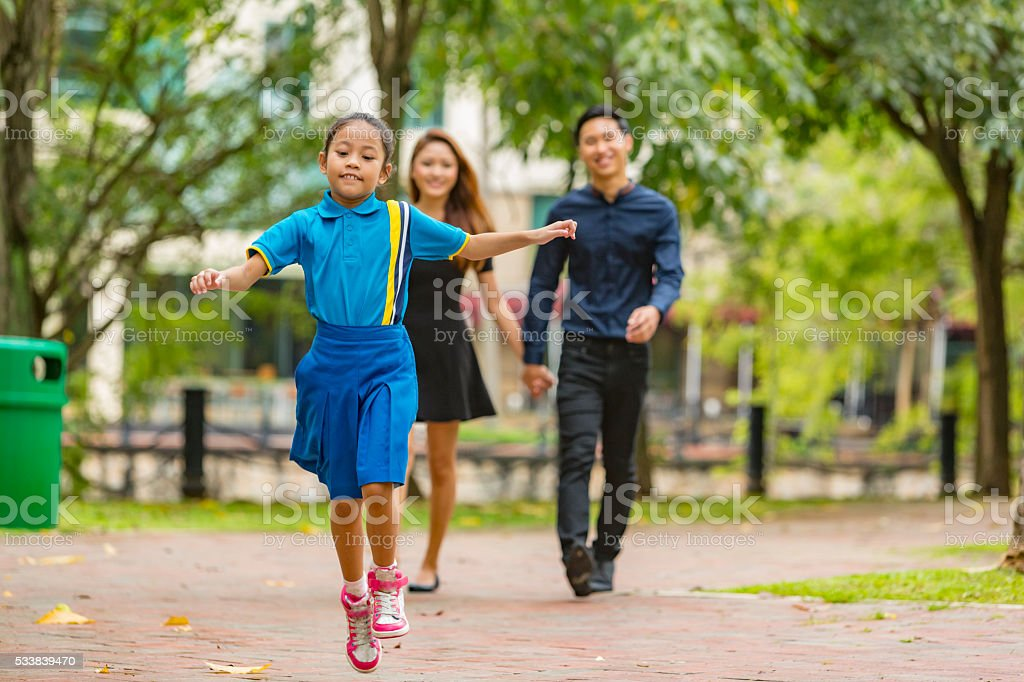 Young Happy Asian Family Walking Together in the Park stock photo