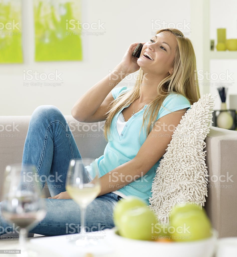 young happy blond talking on the mobile phone royalty-free stock photo