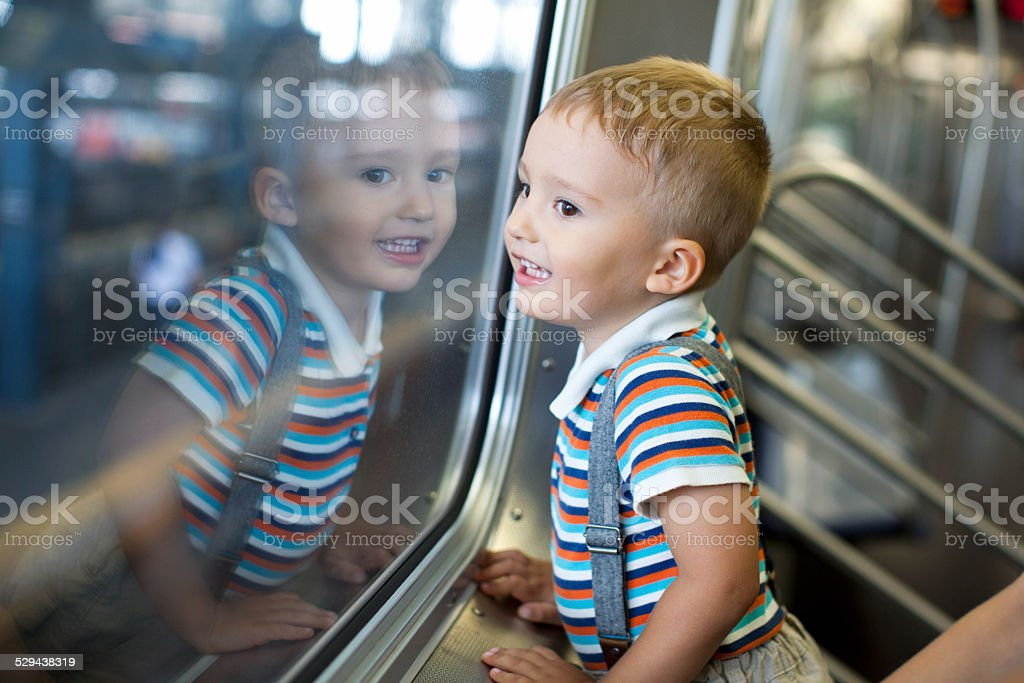 Young happy boy on train stock photo