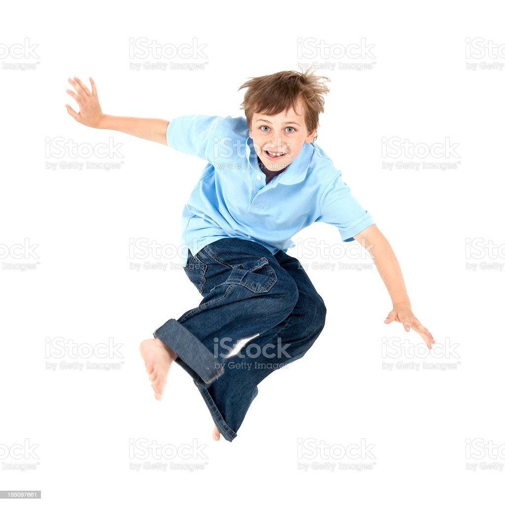 Young happy boy wearing a blue shirt jumping in the air royalty-free stock photo