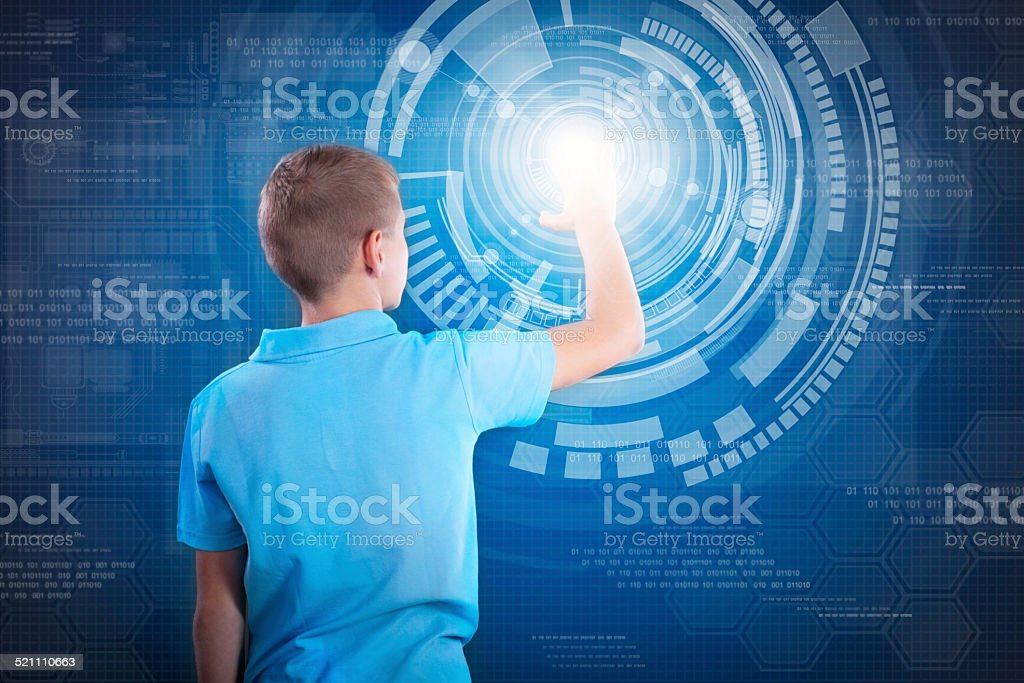 young happy boy working with digital virtual screen stock photo