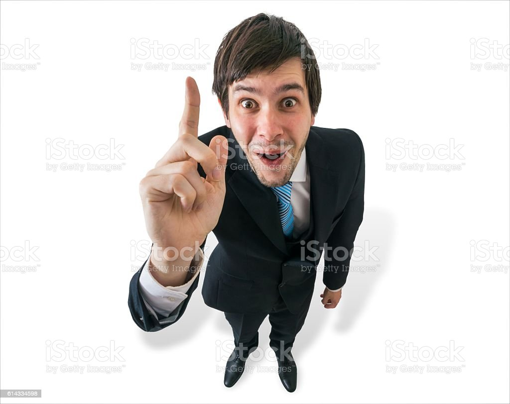 Young happy businessman have an idea and holds finger up. stock photo