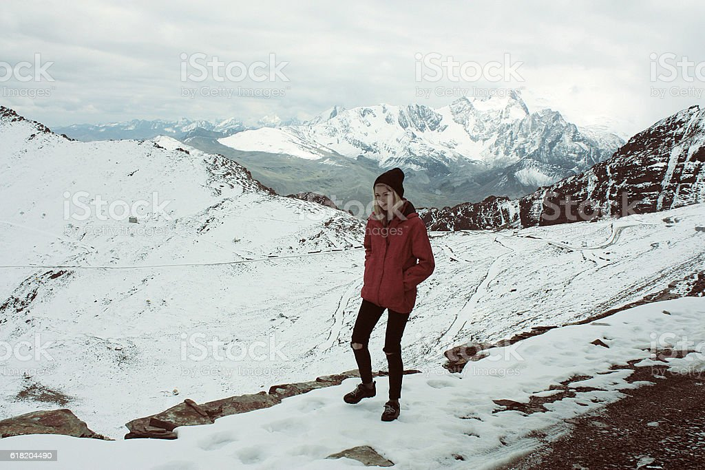 young happy caucasian woman in red jacket bolivian mountains, Bolivia stock photo