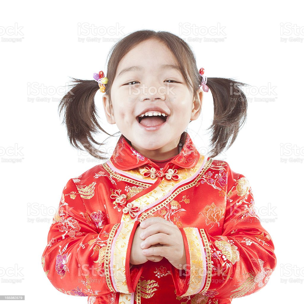 Young happy Chinese girl dressed for Spring Festival stock photo