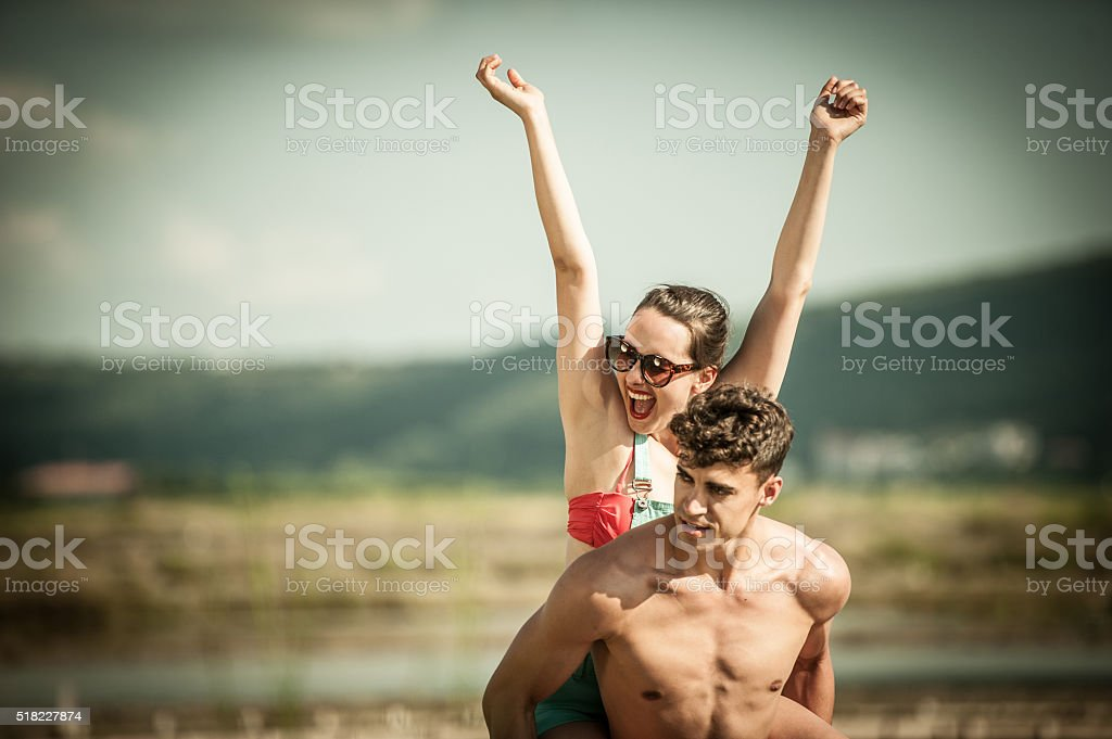 Young Happy Couple having Fun on Summer Vacations stock photo
