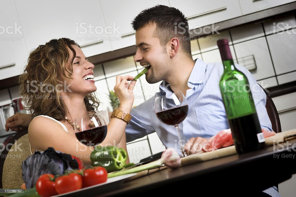 Young happy couple preparing lunch in the kitchen royalty-free stock photo
